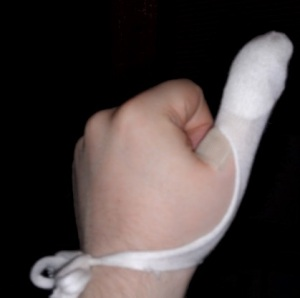 Patching my thumb with gauze