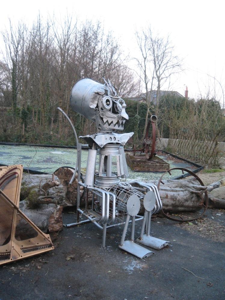a friendly robot, sitting down