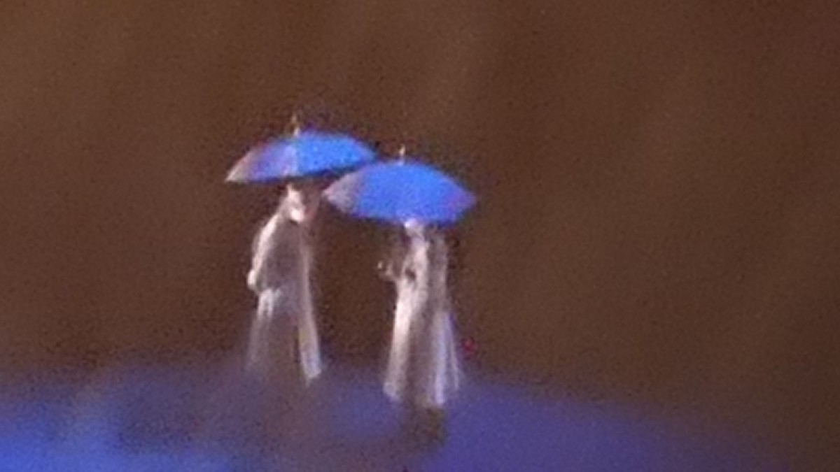 Two people meeting in secret in the rain