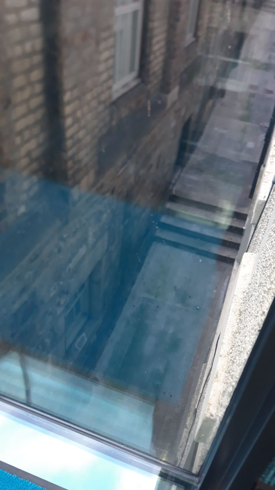 Looking down on some stairs through glass