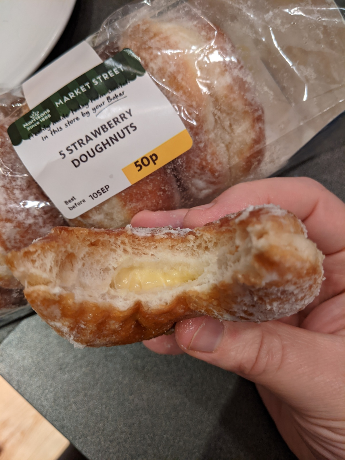 A packet of doughnuts marked as strawberry, but with a custard filling